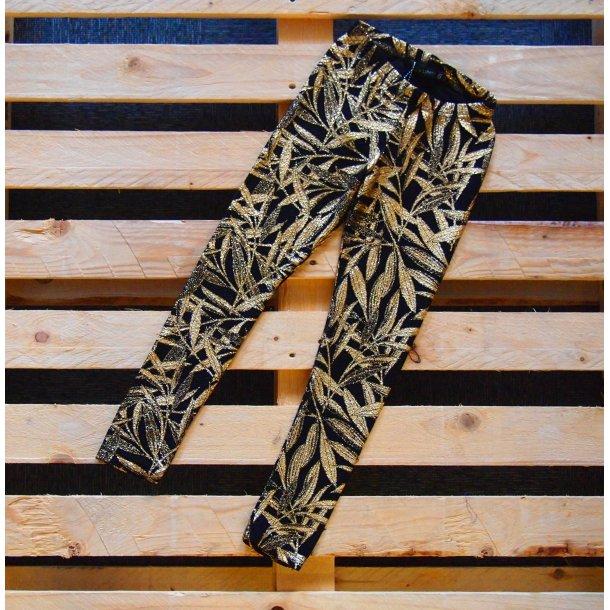 Cool schwarze Leggings mit Gold Muster